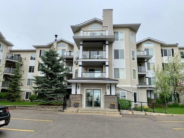 Beautifully kept 2 bedroom condo in The Pavilions at Rocky Ridge!� Suite is a corner unit on the 3rd floor and has views of walking paths and green space.� Enjoy this bright and spacious 2 bedroom, 2 bath unit.� Master bedroom has private en-suite and large closet. The second bedroom is on the other side of the suite for added privacy.  Other features include large windows, corner gas fireplace, in-suite laundry, all appliances, covered balcony, nice sized kitchen with plenty of cabinets, storage locker, titled underground parking stall in heated parkade and is close to many amenities including the LRT station.