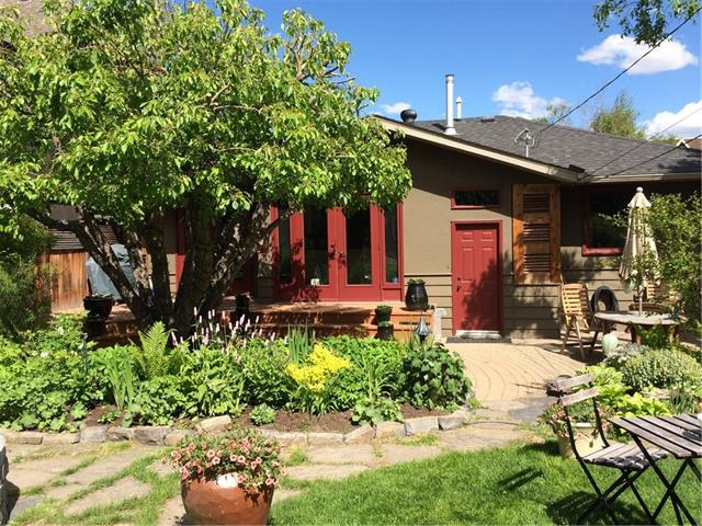 Homeowners say thank you all front line workers! Imagine unwinding at the end of the day with your glass of wine or cup of tea in your sitting area over-looking your beautifully landscaped oasis of a West back yard teeming with perennials and featuring a soothing brook and pond! Enjoy delicious appetizers created in your updated gourmet inspired kitchen with premium appliances including a gas cook-top, professional exhaust fan and an ingenious spice pantry. Entertain in the elegant dining room and gather around the fireplace after dinner in the lovely living room. Fantastic upgrades include newer windows, lighting, the gorgeous main floor bathroom with fresh paint and the fully updated basement with a built in bookshelf, a laundry room you will actually want to use, a second fabulous bathroom, third bedroom and insulated utility room with a new furnace, upgraded electrical, plumbing, ceiling insulation, air conditioning, air filtration system and all done to code. Located in coveted Briar Hill!