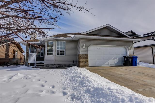 Incredible VALUE for this BRIGHT and CHEERY bungalow BACKING Onto GREEN SPACE! The spacious eat in kitchen has a patio that leads to your DECK and fenced backyard overlooking GREEN SPACE and tobogganing hill. There is also a large living room and dining room. The master bedroom has a WALK in Closet and a full EN-SUITE. There are 2 additional bedrooms on the main floor and another full bathroom. The basement is ready for your finishing touches. There is also a DOUBLE ATTACHED GARAGE. Small town living - yet close to the City! Don?t miss out on this BEAUTIFUL home!