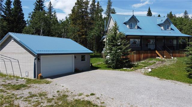 If you're looking for peace & quiet in the country check out this property Located in Waiparous with direct access to 275 acres of forested provincial crown land known as The Back 40 Ghost Waiparous Trails. This 1.76 acre has a wonderful 2 storey home with 8 x 40 ft front deck & 10 x 40 ft back deck & gas BBQ, 30 x 26 ft garage with infloor heat, 160 ft well producing 7.5 gpm. Great firepit area with benches. Also large storage shed. The house has an awesome kitchen with double drawer dishwasher, gas top stove, built in oven ,SS fridge & large walk in pantry. Main floor laundry with Bosch washer & dryer, Master bedroom on main with full wall wardrobe & closet, ensuite with double sinks, soaker tub & separate shower. 9 ft knock down ceilings & rough in for gas fireplace. Upper level 2 bedrooms with great views, washroom & storage areas. Lower walk out basement has infloor heat, Soapstone wood burning stove, Alder doors, Armoire in bedroom, storage room, cold room & large family room with built in wall unit