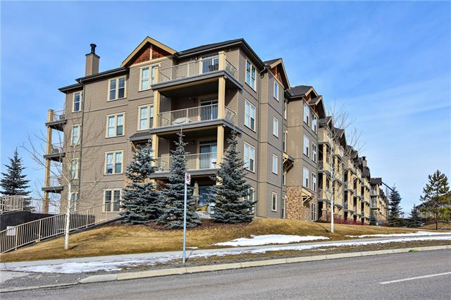 Welcome to the Alora condo in the desirable community of Sunset Ridge in Cochrane! This 2nd floor well maintained 1-bedroom 1-bathroom unit features 9-foot ceilings, modern kitchen with breakfast bar, designer nutmeg cabinetry, tile back splash & sleek black appliances. The bright living area/den opens up to the balcony where you can enjoy your morning coffee & there is room for a BBQ. This home includes a separate office/den area with room for a large corner desk and shelves. The Alora features a state-of-the-art gym & 2 guest suites for those out of town visitors. The complex is perched on top of a hill with some breathtaking views of the mountains and Cochrane and is close to schools, shopping, restaurants, and is only 15 minutes from Calgary & a 45-minute drive to the mountains. Don?t miss out on this one!