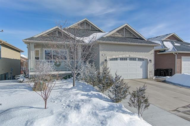 Immaculate WALKOUT bungalow located in Strathmore Lakes Estates on a quiet street. Open concept, fully developed with a total of 5 bedrooms and 3 full bathrooms including a large vanity, jetted tub and separate shower in the master en-suite. The large eat-in kitchen boasts STAINLESS steel appliances,  all new GRANITE countertops, and Large island along with maple cabinetry. Main floor laundry. Oversized living room with cozy gas fireplace.  Deck is complete with Gas for your BBQ. Lower level is complete with 2 large bedrooms, a summer kitchen, 2nd gas fireplace and lots of room for a large family or separate space for the In-laws.  The Double Garage is insulated and HEATED.  Beautiful landscaping complete with custom concrete work and underground sprinklers to be installed