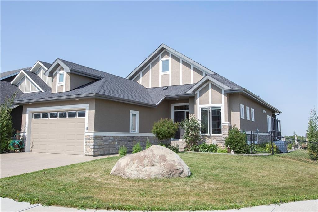 Stunning, fully finished, bungalow with over 3300 sq ft of living space on a beautifully landscaped CORNER lot!! Love this spacious, open concept home with so many upgrades!Main floor sports hardwood throughout, tray ceilings (with led lighting) and huge windows overlooking the Muirfield Lakes Golf Course. A chef/entertainers dream kitchen with a six burner Decor gas stove, extended island with eating bar, pantry and plenty of cupboards. Enjoy sitting by the fire in your living room, watching the sunsets or the golfers. The master bedroom has beautiful views through large windows.With tray ceilings,a spa like ensuite and walk in closet.Main floor also includes a second bedroom, office/dining room and laundry. Downstairs you will enjoy your dream rec room with fireplace,wet bar, two bedrooms, a full bath plus plenty of storage. Spend your days outside on the private deck, down on the patio, in the green house the lawn. Gas lines run to deck and garage.Lots of extra parking on driveway and side of house.