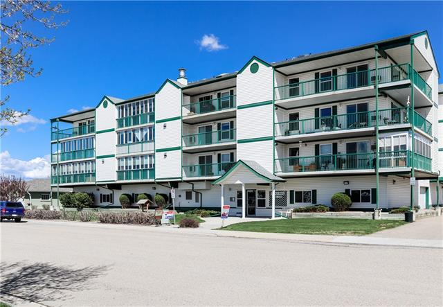 IMMACULATELY MAINTAINED, original owner is selling this great affordable condo in the highly sought after Campus Green building in Didsbury. Just a couple of blocks to downtown and the sports complex with swimming pool, near great restaurants and shops, this 55+ maintenance free lifestyle is ready for you to be able to toss your lawn mower and snow shovel away !  The building also offer two common social / games / exercise rooms. The bright west facing air conditioned unit offers a nice open living / dining / kitchen area, two bedrooms, the second bedroom opening up to the living room making it a great room to use as an office or den as well, in-suite laundry, and a covered deck with two storage units.....all ready and waiting for you to move right in !