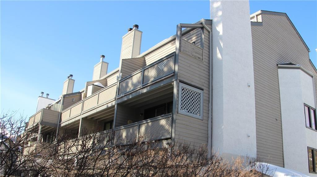 TOP FLOOR Grey Squirrel condo featuring just under 600 sq.ft. of living space with open loft bedroom, full range of appliances, wood burning fireplace, off-street parking and storage locker. This condominium is the ideal starter home or solid rental income holding property.