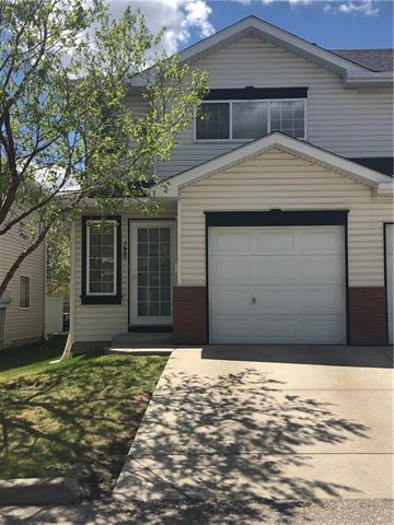This is a great 2 bedroom condo. Updated flooring with a large SW facing living room, gas fireplace and white kitchen with a breakfastr bar and a large dining area. The bedrooms in this unit are huge and each has a walk in closet.  Good sized bathroom and a large linen closet  The patio door opens to a private yard.  This is an End Unit with lots of light and a larger yard than most of the complex has.  An Unspoiled basement and a single attached garage. Low Condo fees and includes 5 appliances. Freshly painted throughout.