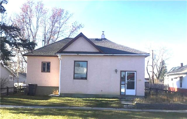 Charming and Affordable! Super cute bi-level in the quiet community of Blackie just east of High River. Very Large back yard with back Alley access. NEW LAMINATE FLOORING! Don't miss out on this great property!