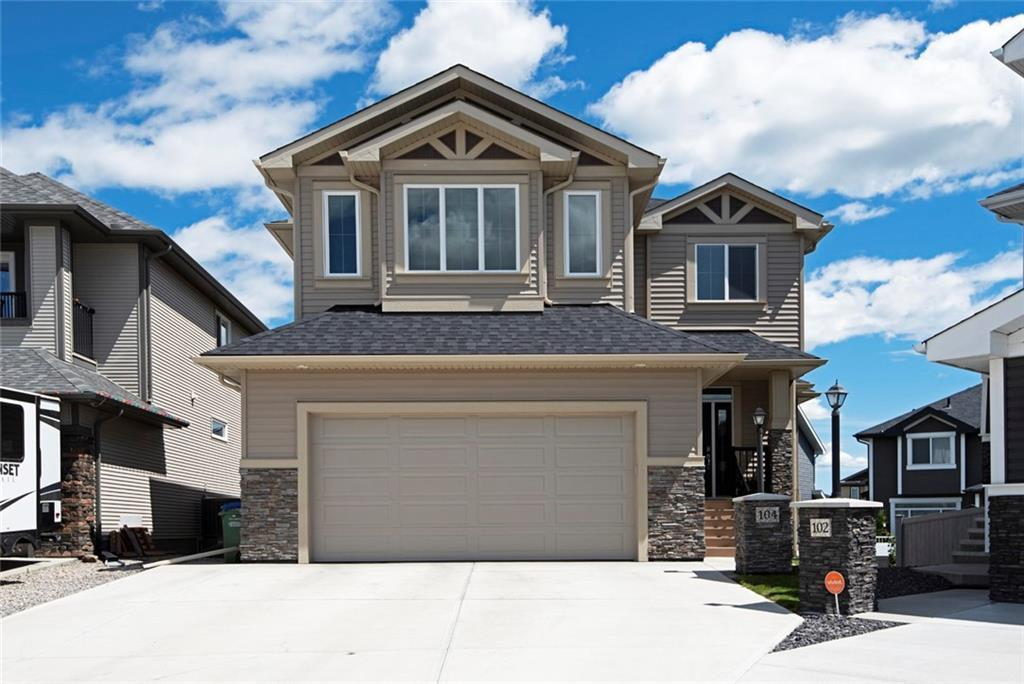 """CLICK THE MULTIMEDIA BUTTON FOR A 3D TOUR, MORE PHOTOS & A FULL DESCRIPTION OF THIS CUSTOM BUILT HOME & ITS MANY UPGRADES. Fully finished 2 storey walkout home, on a large pie shaped lot, in a quiet cul-de-sac that's close to Okotoks' best shopping. Stunning tile entrance leads to a lovely living room with a feature fireplace. The fabulous kitchen has 1 3/8"""" granite, upgraded cabinets, Frigidaire Professional & Miele appliances & is open plan with the spacious dining nook. Upstairs has a large bonus room, 3 great bedrooms, the master with a luxury walk in closet & 5 pc en-suite with in floor heat. There's also an upgraded family bathroom & a terrific laundry room. The walkout basement offers a superb wet bar, huge family room & a generous 4th bedroom with an adjacent upgraded bathroom with in floor heat. There's also ample storage space. Out back, you'll find a main floor deck with glass panels & a concrete patio beneath, whilst there's masses of space for the kids to play & a garden area. MAKE IT YOURS!"""