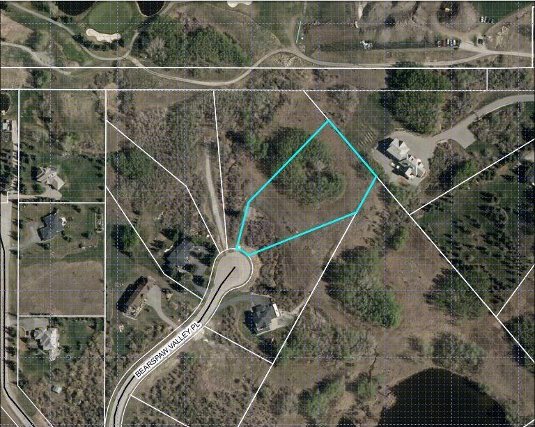 Build your dream home and enjoy the best of both worlds: country living with all the amenities of the city nearby. This private lot located at the end of a paved cul-de-sac is just under two acres. Partially treed, the area is abundant with wildlife. Privacy and tranquility are yours while keeping you close to grocery shopping and other amenities just five minutes away. You are minutes away from the Bearspaw Golf Club. Commuting to downtown is quick and easy utilizing the Tuscany LRT station, or drive the straight shot down Crowchild Trail to the city center. Services are readily available and the water is through the Rocky View Water Co-op with the water certificate already paid for by the developer. No timeline to initiate a build and you can choose your own builder. Easy and enjoyable country living is available for you and your family. Your dream home awaits your imagination.