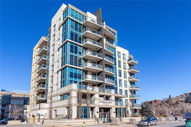 """*** LAST CHANCE TO VIEW IT AS A VACANT PROPERTY *** This unit is Move-In Ready... You will enjoy 11'6"""" ceiling height in most of the unit! CLICK on the 3D link... There is a private & quiet Patio for Bar-BQ as your outdoor area. One Bedroom, One Bathroom, Plus a Den. Titled Heated Underground Parking. Security and Concierge on a Daily & Full-Time basis. Do not miss this opportunity. Situated in a GREAT LOCATION to enjoy walks by the River in the midst of Downtown Calgary. First-time buyers, this unit awaits you, the condo fee includes ALL utilities except Electricity which is low on a monthly basis. Call your favorite REALTOR & you will not be disappointed!"""