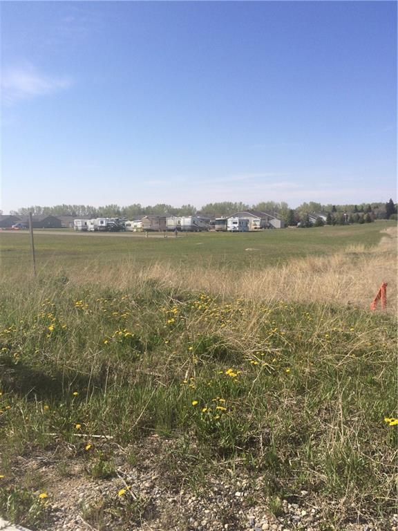 Small town living at its best!!  Great corner in Whispering Greens adult community in Vulcan.  Fantastic location to build away from it all!  Seller is open to all offers including trades.  Located just an hour SE of Calgary.  Perfect location if you are looking for a maintenance free and in a golf community.