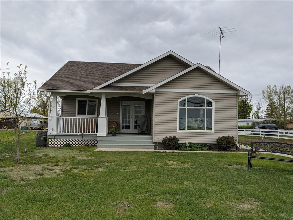 Needing some space away from it all?   This bungalow, built in 2011, is in the Village of Carmangay, Alberta, along Highway #23, just 62 km north of the City of Lethbridge. This open concept bungalow features a living room, kitchen and dining area on the main floor. Also on the main level are the master bedroom with two piece ensuite bathroom and closet organizer, full bathroom with low flow toilet, and second bedroom. The basement is fully developed with another bedroom, L-shaped family room, utility room, laundry room and theatre room. The family room has a shuffle board, which is included in the sale of this property. In the theatre room, there is a projection TV, which is negotiable with the sale. Extra boxes of flooring in the basement are included as well. Kitchen appliances are newer. The furnace is a high efficient model. Water softener is rented, and so is the alarm system.  Note:  the lot is in the process of taking over half of the lot to the east.  Lot size will be updated once completed.