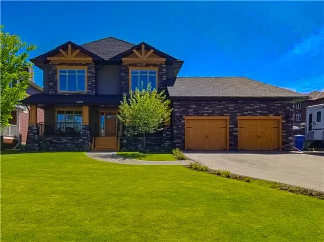 Welcome to this gorgeous, custom built home, featuring over 3250 sq. feet of living space; just steps away to Chestermere lake! The expansive front porch is ideal for enjoying those serene summer evenings.  The main showcases an open layout with a spacious entry way that leads into your den. The kitchen features gorgeous cabinetry with stainless steel appliances, granite counter tops, a large butler pantry & has a spacious dining area that looks out to your massive back yard!  The living room has a coffered ceiling & gas fireplace with stonework to the ceiling. A 2 piece bathroom & laundry room complete the main.   The upper level has a bonus room & three bedrooms; one being your master retreat with 5 piece ensuite which offers a soaker tub, separate shower & double vanity sinks.  The lower level is perfect for entertaining; recreational area, bar, wine storage, bedroom & 3 piece bathroom. Featuring; RV parking, an expansive 26 x 28 garage with 20 amp service & hot/cold water.  Come & see the quality!