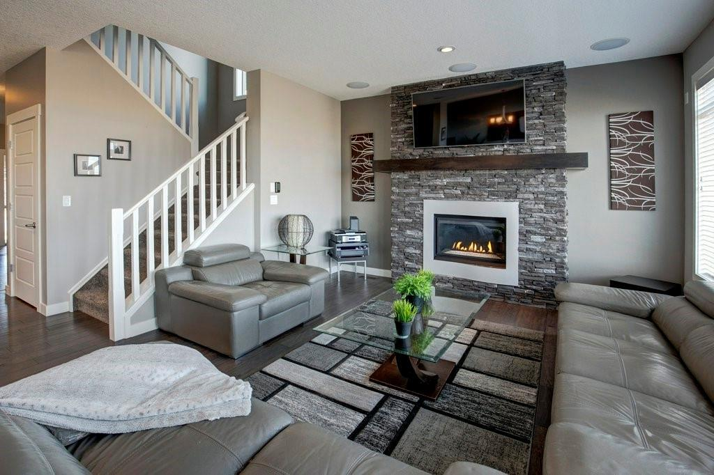 OPEN HOUSE AUG 7th 5-7PM AND Aug 8th 12-3PM. Enjoy the slower pace of life and mountain views in the community of High River! A true family home with 4 bedrooms up and 1 down; beautiful 2015 built home! Inside, a stone fireplace is a focal point, while transom windows and 9-foot ceilings frame mountain views from the living and dining areas. Engineered Hickory floors, granite counters, and Hunter Douglas blinds are gorgeous upgrades. The kitchen offers high-end appliances, a HUGE pantry, and a wine nook off the dining room. The master is a private haven with mountain views, and ensuite upgrades include a rectangular soaker tub. A family room wired for a home theatre and a 5th bed and 3pc bath make up the basement. The triple tandem garage opens to an entry with 12-foot ceilings, unique architecture, and extra storage. The home boasts built-in speakers, LED lights, dual furnaces, and on-demand hot water. On the back lawn, two decks and a fire pit form an oasis with no rear neighbours! Walking paths, schools, and all amenities are within minutes. Note On Triple Garage: One Side is Tandem Stall measuring 34? 11? Deep.