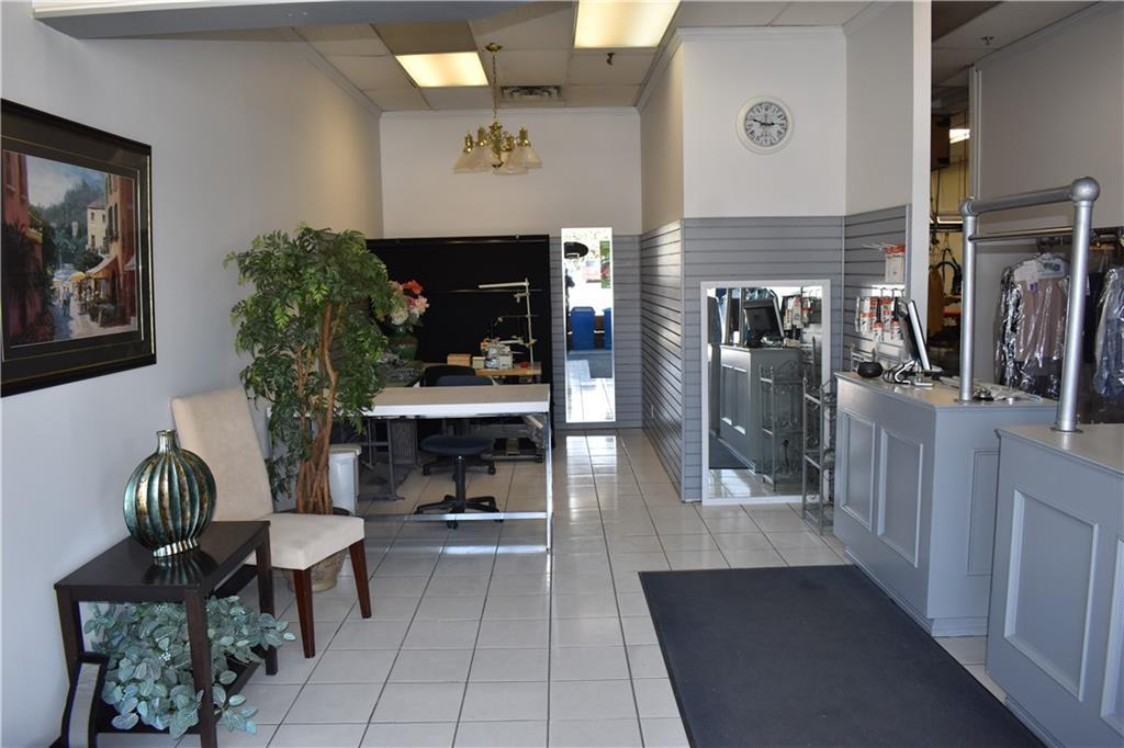 Here is your chance to own an established business at an unbelievable price!  It is located in a thriving SW  strip mall which includes a Safeway, Tim Hortons and a shoppers drug mart. The current owner has operated the business for over 20 years and is willing to train the new owner if desired.   A highlight  is the  swamp cooler in the back room to keep the area comfortably cool! There is potential for growth to the business with an area that could be used for alterations or other uses.