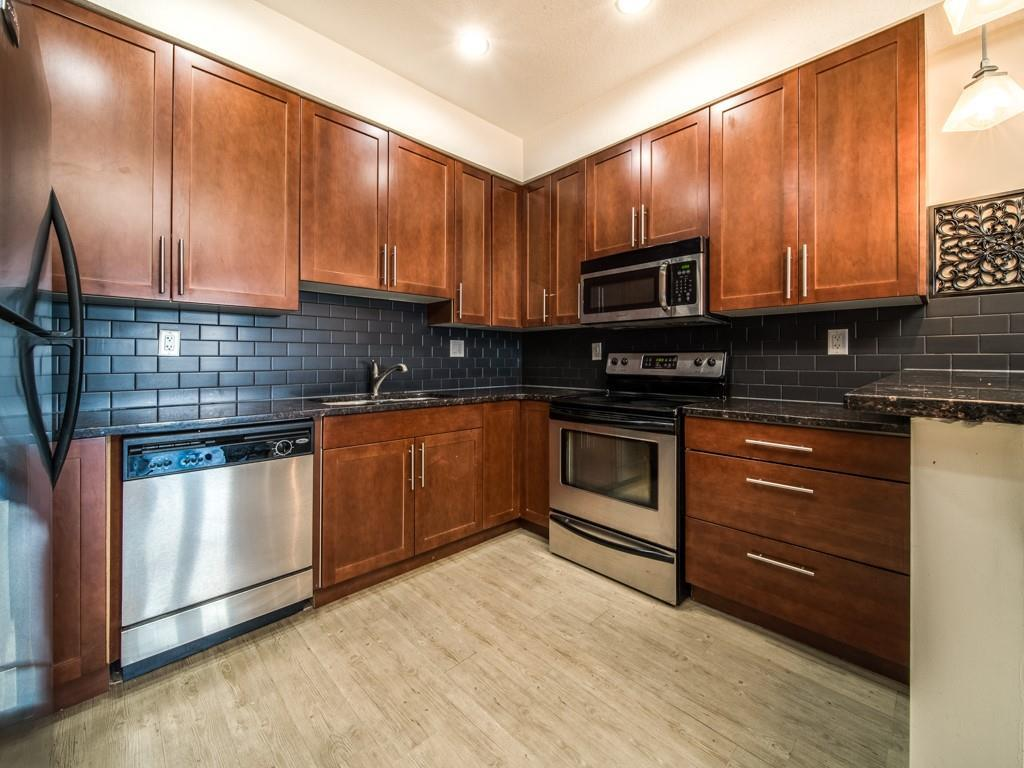 TOP FLOOR UNIT in highly sought after SAVANA COMPLEX in one of the safest communities according to RCMP stats.Beautiful kitchen with TALL Floor to ceiling cabinets accented with STAINLESS STEEL APPLIANCES,GRANITE Counter tops,Subway Tile back splash,Raised open bar ledge with view to dining room and living room.Living room with corner TILE surround Feature fireplace with entertainment ledge above.French doors from living room to Large covered balcony with gas hook-up ,Great view to open grass area and trees.Large master bedroom with His/Her closet and cheater access door to 4 Pce .bathroom with Tile flooring and floor to ceiling Tile tub surround. Unit has beautiful WIDE plank laminate hardwood flooring ,En-suite laundry,Private Tile foyer entry. TWO parking stalls ,UNDERGROUND heated stall #149 with secure VERY LARGE storage unit in front of stall,outside stall #228 is close to front door,LOTS of VISITOR parking.The LUXURIOS SAVANNA COMPLEX has GREAT view & walk to LAKE & Playground,walk to SHOPPING.