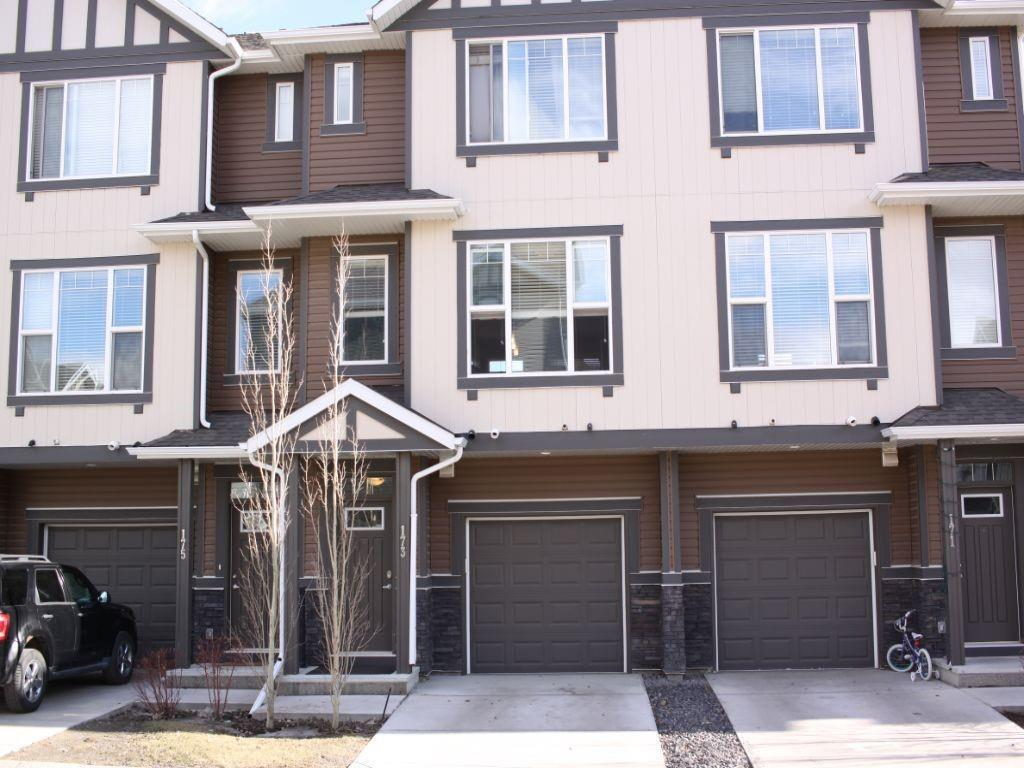 This stunning 2 storey townhome with an attached tandem garage is your next move! This 2 bedroom, 2.5 bathroom home offers low condo fees, 9 ft ceilings, quartz counters, stainless steel appliances and south facing back. This home is so conveniently close to Stoney Trail, South Health Campus, schools, and restaurants. The main floor offers-length of natural light, laminate floors, and an inviting living room & dining room. It also has a modern kitchen that boasts a white tile back splash and a centre island breakfast bar. Upstairs features a laundry room, 2 enormous master bedrooms each on opposite sides, each with their own Walk-in closets and full en-suites. Relax and enjoy the sun on your quiet and perfect size deck, with quick access to green space and many shopping stores. This home is in a great location and offers great upgrades to suite your needs. MUST SEE!!!