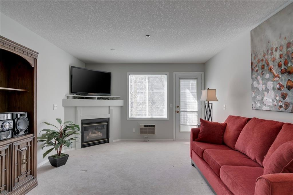 | Two Bedrooms & Two Bathrooms | Great Amenities | Low Maintenance | Central Location | Welcome to Glenmeadow Garden, where low-maintenance adult living is at its best! This 55+, centrally located, 2 bed, 2 bath condo features just under 1,100 sqft of living space and a large balcony. Upon walking in you will be welcomed with a spacious living area that includes a kitchen, living room and dining room. The kitchen comes with an island with an eat-in bar and lots of cabinets. The combined living and dining rooms have plenty of space for you to entertain and enjoy family meals. The master bedroom easily fits a king bed and sports a walk-through closet with an en-suite. The unit also features A/C, in-floor heating, in-suite laundry, a huge storage locker and underground parking. The building comes with secure entry, an elevator, a gym, a rec area with billiards and shuffleboard, a library and a courtyard that features a gazebo. With Signal Hill Centre a 5 minute drive away, you'll have easy access to shopping, restaurants and a movie theater. Don't miss this listing!