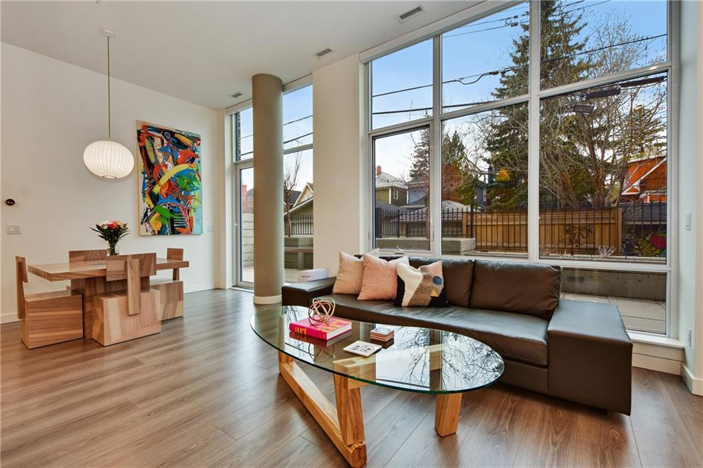 A fully zoned L I V E | W O R K unit in the heart of Kensington. You need to see this space! Shortly after entering, you are greeted with the wow factor of towering 11 foot ceilings + wall to wall west facing windows. 