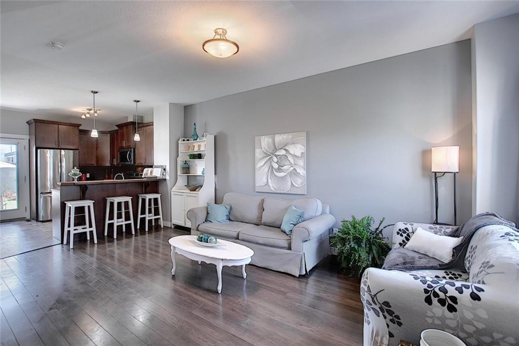 Seller is offering TO PAY 4 MONTHS OF CONDO FEES FOR THE  BUYER. Country Living within 25 mins to the city with LOW condo fees $ 240.00 pr month. Welcome to this renovated 2 Storey townhouse, shows 10/10 and BACKING ON TO GREEN BELT, with a fully professionally developed basement This home features over 1330 Sq.ft total living space with 4 bedrooms and 4 bathrooms. Modern touches throughout, freshly repainted, new laminate flooring, new carpet, new microwave hood fan, built-in dishwasher with in the last year. Bright and open concept on the main floor with a spacious living room that flows into a well-equipped kitchen with stainless steel appliance package, rich Espresso cabinets, including DD sink w/ tons of counter space and spacious dining room area. The upper level is appointed w/ 2 large bedrooms plus a Master bedroom with 3 pc ensuite and walk-in closet. The lower level is completely professionally finished with a large bedroom,4 piece bath, rec room, and laundry room w/ extra storage. South facing patio backing on to a green belt, walking distance to school and shopping nearby.