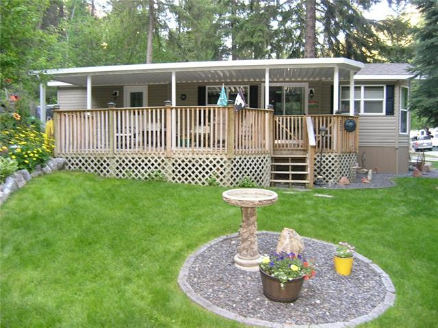 Own a Piece of Paradise at Creekside in the Canyon, RADIUM HOT SPRINGS, BC. Full Ownership of 12x44 Park Model and Lot. Move in Ready, fully furnished and equipped,immaculate 2010 General Coach Park Model. Enjoy shade under 10x32 metal roof or sun on adjoining 8x16 deck. Large private lot w/irrigation system. Backs onto natural hillside. Sleeps 4 w/separate bdrm, queen hide-a-bed, 3pce bath & window valances w/day & nite shades. Open plan w/vaulted ceilings, spacious living rm w/fireplace, great kitchen design w/snack bar & separate eating area. Storage shed, A/C, full size propane tank & insulated skirting. Park fees $1350. annually includes water, sewer, lot tax, use of onsite heated pool, lawn maintenance & plowed roadways. Take in relaxing spa at Radium Hot Springs pool, swimming & boating at Lake Windermere, annual classic car show, skiing at Panorama or golfing at one of the many golf courses. Great restaurants & shopping. Vacation Property 2.5 hours from Calgary w/IMMEDIATE POSSESSION! GREAT VALUE!
