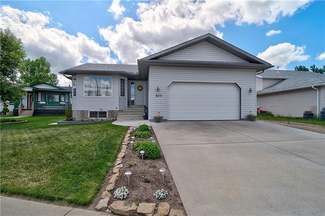 Impeccable Care taken for this Quaint Bungalow in the Small Town of Irricana. MASSIVE LOT featuring RV Parking, Mature Trees & Landscape, Established Garden, Huge Deck w/Enclosed Gazebo (perfect for a Hot Tub), Concrete Retaining Wall & Gardening Shed! Upon entering you?ll find the Living Room w/Bright Bay Windows & Gas Fireplace. The Kitchen is tucked Privately away from the entry. It features Ample Counter Space incl. Island, Ton of Cabinetry & Pantry for Storage. Beautiful Backyard View from the kitchen sink. The Dining Area was built specifically to Host a Large Family, with Easy Access to the Deck & Natural Gas BBQ Hookup. The Master Bedroom w/ensuite is also on the main floor. Basement offers a Huge Rec Room w/Pot Belly Gas Stove along with 2 Additional Bedrooms (one w/Ensuite). More to Love: NEWER ROOF, CENTRAL A/C, HEATED GARAGE, ORIGINAL OWNERS, Never Smoked in & No Pets, TURNKEY & CLEAN AS A WHISTLE! Come for a Visit and Maybe Just Stay a Little While Longer?