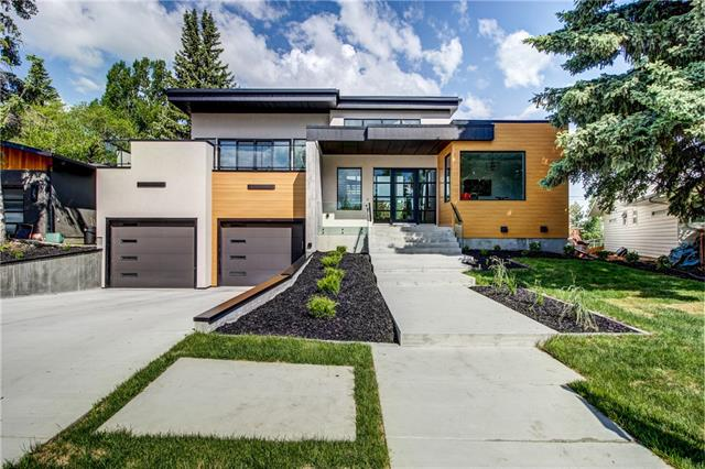 Built by West Ridge Fine Homes, the stunning modern architecture and design of this handcrafted home are showcased by the gorgeous wood features, large windows, and above garage patio with views of the river and valley. Inside you are met with quality craftsmanship and chic character throughout the open floor plan with soaring ceilings and windows that fill the home with bright natural light. The gourmet kitchen boasts designer millwork, a large centre island, and high-end Miele appliances. The great room windows bring breathtaking views inside the soaring living space with 18? 3? ceilings. The main level master bedroom, with 14? ceilings, includes an expansive walk-in closet, exterior deck, and spa-inspired ensuite with deep soaker tub, double vanity, and glass rain shower. Ascend the grand staircase to the bonus living room with 385 sq.ft. balcony and two bedrooms each with an ensuite bath.