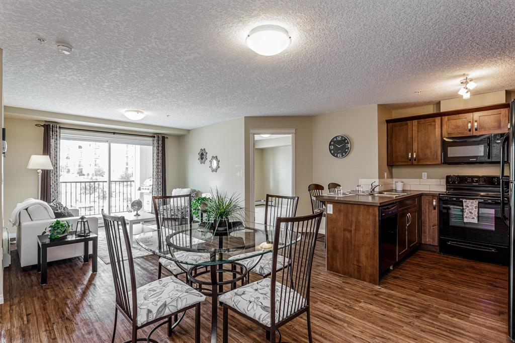 MOTIVATED SELLERS AND EXCEPTIONAL VALUE  on this well kept 2 bedroom, 2 bathroom unit on the second floor of Sage Place! Glistening with pride of ownership, this open concept unit is complete with vinyl plank flooring, upgraded kitchen, ample sized bedrooms and a titled parking stall just below your balcony! Unit boasts roughed-in A/C, slow close cabinetry, gas line for BBQ, upgraded appliances and a separate storage unit located in the heated underground garage. Large, bright master bedroom provides a generous walk-in closet and a spacious en-suite. Second bedroom is on the opposite side of the unit for maximum privacy, and situated next to the efficiently located second bathroom. Laundry room has ample space for all your storage needs! Plenty of visitor parking just out front. Conveniently located within walking distance to schools and shopping; and with Sage Hill Quarter in progress right across the street, it will be a one-stop-shop for all your household needs! Easy access to Stoney Trail makes commuting a breeze! BBQ on balcony included.