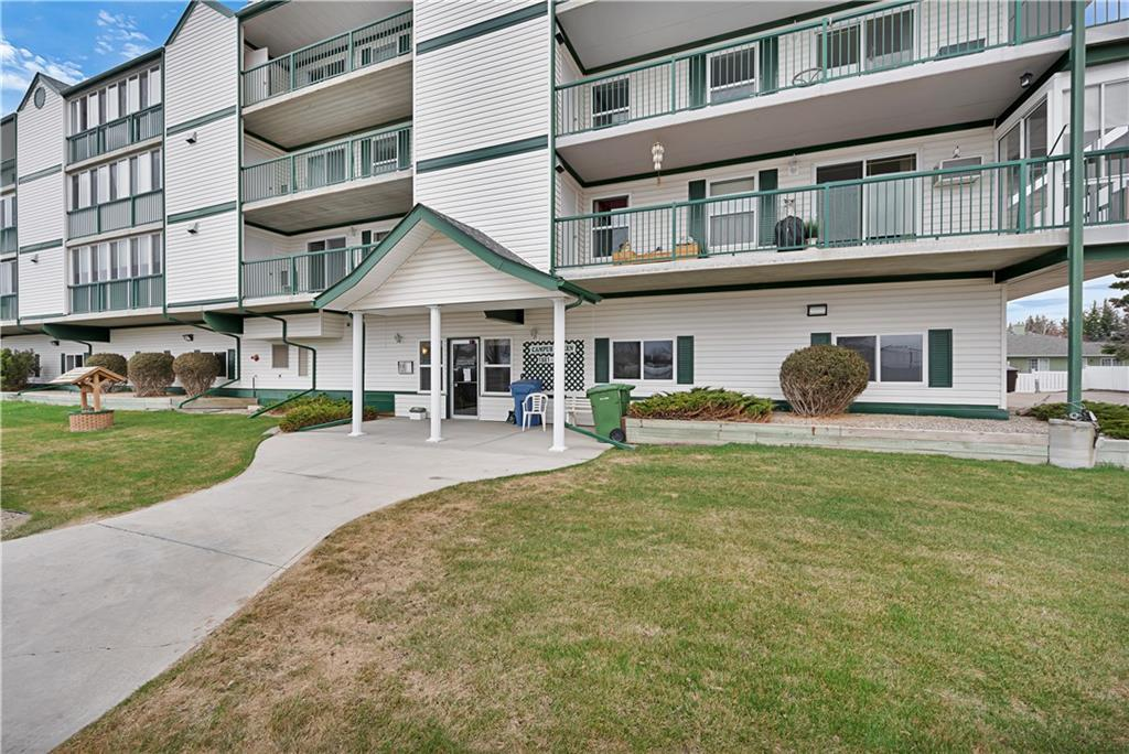 THIS COULD BE YOUR NEXT HOME! Check out this condo in the Town of Didsbury. This Campus Green unit has A/C and is west facing so you can watch what's happening in town. It is close to the rec centre and the post office so all you have to do is enjoy life with less responsibilities. The unit is ready to move into and features a spacious kitchen/dining/living area, 2 bedrooms, 1 full bath and in suite laundry. The balcony is a great place to enjoy the upcoming summer days and there are storage units at either end so there's lots of space for those extras. The apartment building has indoor heated parking, a social room, a kitchenette, workshop, elevator and lots of nice people reside here. Come for a look today!  IMPORTANT RE: COVID19- YOU MUST COMPLETE THE DISCUSSION CHECKLIST BEFORE VIEWING THIS PROPERTY.