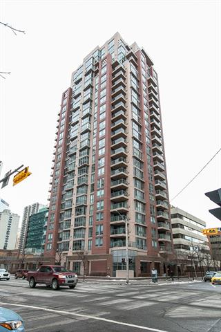 Welcome to your move in ready home in the desirable Axxis Condo! This 7th floor Southwest facing corner unit with ceiling to floor windows is flooded with natural light. With almost 1000 sq. ft of living space, you will find 2 large bedrooms, double closets in the master along with a 4 piece ensuite. The kitchen offers an island and boasts under cabinet lighting. The dining room and living room are both a generous size in this open concept home. The living room features a stone tile surround gas fireplace and access to your private patio. The building offers a workout facility, main floor washrooms, a social room, bike storage and secure visitor parking. This well run building is perfectly located a block from the river, steps to restaurants, a short walk to Kensington and half a block from the free LRT zone.