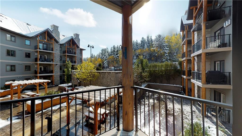 55+ Building.One of the nicest condo buildings in Cochrane to live in that promotes great community atmosphere.This building features common rooms such as library, Pool table & games room,TV room, puzzle room, full kitchen & dining and separate suite for day rentals.This 2 bedroom unit is on the south side overlooking the courtyard that has sitting areas & barbecue & fireplace area.This allows lots of sunshine into the bedrooms & living room area.The deck with separate storage room is a big plus.Each of the two bedrooms has its own washroom space. The master has a large walk through closet.The Kitchen is awesome with granite counters, raised breakfast bar, lots of cabinets & counter space with open concept to the dining & living room area. Also has insuite laundry. Stairs or elevator access. Underground parking stall #7 & storage #58 comes with the unit. Only a few minutes bus ride to Spray lakes leisure & rec center.