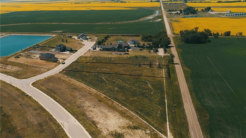 This acreage is priced to sell!! Build your dream home today on a FULLY SERVICED ONE ACRE lot located on a quiet cul-de-sac. As part of Lakes of Muirfield, a gated golf course community, enjoy municipal sewer, water and electricity (including 200amp service), garbage pick-up and snow removal. NO BUILDING COMMITMENT and 40% site coverage allowed (17,400 sq ft)! Stunning mountain views, incredible sunsets and wide open spaces could be yours. Lakes of Muirfield boasts the Muirfield Lakes Golf Course and Clubhouse, Liquor store, Cafe'/convenience store, Private RV Parking, Canals, a tot-lot and that sense of community that is hard to find. School bus stops just down the street and you are conveniently located only 20 minutes to the airport and Cross Iron Mills, 15 minutes to Strathmore and Chestermere.