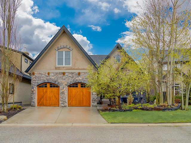 This custom-built 5bd/3.5bth executive bungalow in Tuscany Estates is a true dream! Enter the foyer & take note of a spacious dining room w/ coffered ceilings, & convenient wet bar & pantry access through the french doors. The living room is complete w/ soaring ceilings, gas fireplace, custom lighting & access to the deck. The kitchen has granite countertops, gas range, custom finishes & sunny breakfast nook. The master suite awaits you w/ juliet balcony, exquisite bath w/ steam shower, soaker tub, skylight, double sinks & walk-in closet. 2nd bedroom, 1/2 bath & laundry can be found on this floor as well. Upper level boasts private bedroom & 4pc bath. Head down the spiralling staircase to a spacious walk-out basement w/ large rec room, family room, 2nd wet bar, den, 2 large bedrooms, 4 pc bath, 2nd laundry room & storage space. The views of the ravine and luscious front & back yard will impress. This home has an oversized dbl garage, included pool table & close to many amenities. Book your showing today!
