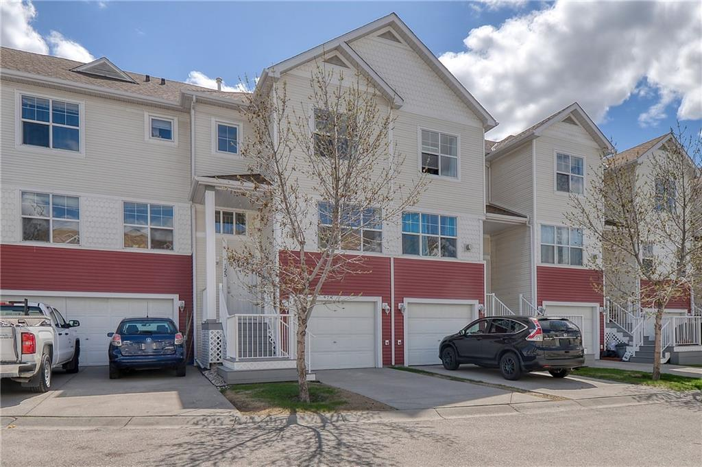 This bright and spacious townhome features a three-level split layout located in the awesome community of Country Hills Village. It boasts 3 good-size bedrooms, an ample family room and 2.5 baths. Step into a bright front foyer with soaring ceilings and a large closet to tuck everything away. The open-concept main level is full of natural light with a cozy corner fireplace. The functional kitchen has plenty of cabinets and comes to a sunny eating area that steps out onto a beautiful back deck. Upstairs you will find two bedrooms with a nice view and a master bedroom with a 4-piece en-suite bathroom. A convenient upstair laundry room completes this upper floor. As you enter from the walkout basement you are guided to a cozy family room. The attached garage is extra long to accommodate storage or provide you with plenty of room for your car and bikes! Being a Townhouse providing an unbeatable location within walking distance to the lake, Superstore, shopping centre, public transit and so many more amenities are added bonus. Immediate possession available, come see this little slice of heaven today!