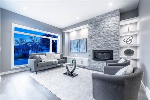 **CHECK OUT 3D TOUR** Luxury & quality emanates throughout this brand new home in Banff Trail!  Over 2,625sf of developed living space featuring 5 bedrooms! Soaring 10 ft ceilings throughout & spacious open concept gives you a grand entrance & open living area w/ gas fireplace. Featuring a gourmet kitchen w/ full height two-toned cabinetry, gas cook-top stove, built in oven & microwave, quartz countertops, & formal dining area. This custom home was built w/ natural light & storage top of mind! Multiple skylights throughout & vaulted ceilings truly welcomes an abundance of light throughout the day, along w/ custom built-ins throughout. Upstairs has the perfect space for an at-home office & the luxury master bedroom & elegant ensuite features vaulted ceilings, large walk-in closet, & heated floors. The lower level features 9 ft ceilings, rec room w/ wet bar, full bath, & 2 additional bedrooms.Steps to Canmore/Confederation Park, William Aberhart School & 10 minute walk to Banff Trail Station make for an