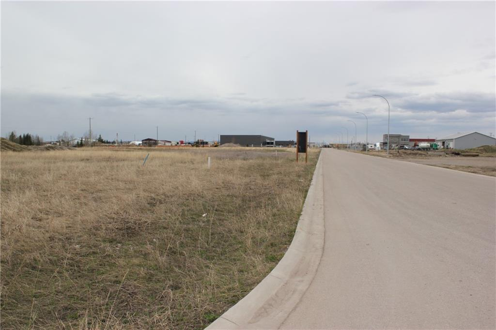 LARGE 1.22 ACRE CORNER LOT - Light Industrial - build ready - flat site - services to the lot line - great HIGH EXPOSURE location across from truck/car wash & in front of the Jiffy Lube.  Steady traffic in this developing area in the south west part of town.  The potential for attractive/popular businesses in this area is endless! Act now before this property is gone!