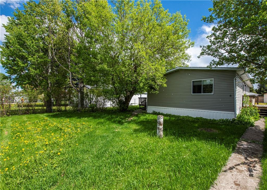 Located on a quite street in Sundre this mobile home sits on its own fully fenced lot with plenty of parking for all your vehicles either in front of the home, behind the home or in the 26'X26' detached garage. The home has had some upgrades over the years and contains an ample size living room with laminate flooring, a spacious dining area with built-in cabinets, a full size kitchen, three bedrooms and a convenient laundry room. Only minutes away from Sundre golf course and walking distance to some local shopping this home is ideal for anyone just starting out or consider adding it to your rental portfolio. Call your realtor today for your own private viewing.