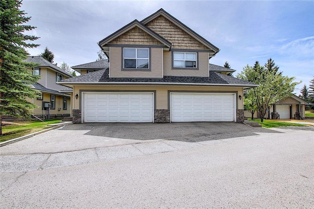 Welcome Home! A bright and spacious 4-bedroom townhouse with attached double garage in the desirable scenic south west. Fantastic layout featuring a formal entrance to the spacious living room with cozy gas fireplace. The large kitchen includes granite countertops, lots of cupboard space & eat up bar looking over the dining room. Sliding doors & windows bring in loads of natural light and lead to a quiet south facing patio/green space. Upstairs you will find 3 large bedrooms including the master bedroom with a walk through closet to the 4pc en-suite. Relax in the fully developed basement with a 4th bedroom, a bright living space, laundry room, and large finished storage room. From beautiful hardwood flooring to the crown mouldings, this spacious home won?t disappoint.  Minutes from Glenmore Reservoir, Fish Creek Park, Southland Leisure Centre, South Centre Mall, Macleod Trail, the new SW ring road and Costco to be opened shortly. Don?t miss this opportunity and call for your viewing today!