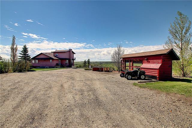 View the Drone video by clicking on the 'Multimedia' button! Are you looking for a quiet and relaxing property where you can unwind after a long day yet still be minutes away from Calgary and Strathmore? This unique property is situated on 16+ acres and is located just minutes from both Carseland-Wyndham & Johnson Island Provincial Parks, and the Hamlet of Carseland. Be close to nature, fish, canoe or explore the Trails along the Bow River. Sit on your 10' x 51' deck while enjoying the spectacular views! This home offers a fully developed walk out basement, a total of four bedrooms (room for additional bedrooms in the walk out bsmt), a modern kitchen with Granite Countertops, a Gas Stove & Stainless Steel Appliances. Spacious living room and dining area plus a beautiful sunroom drenched in natural light, perfect for the hobbyist in the family! The private master bedroom has its own walk in closet and en-suite. The in floor heat in the bsmt and the two fireplaces will always keep this home warm and cozy. There is also a separate 'Self Contained' cabin, call to view! Feel free to inquire about the zoning and what businesses might be permitted.