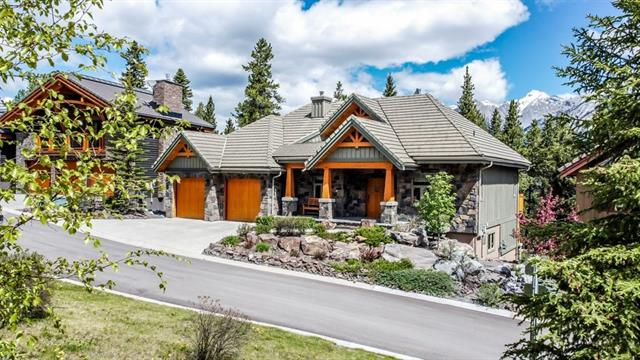 Executive Home in Falcon Lane, 3,168 SQ FT, 5 bed, 3 bath, custom home located in a quiet, exclusive area & overlooks the river valley, with beautiful MTN views of the Fairholme Range & Grotto to the rear & the Grassi Range to the front.  One level living in this walkout designed home with master bed, 2nd bed, kitchen, living & dining all on main level. Superb finishes include stainless, granite counters and cherry cabinetry. A 16' wood burning FP is the focal point of a bright, open living plan, including living room, dining and kitchen.  3 beds plus a den and large family room with wet bar, wine storage & games area, 4 pc bath on the walk-out level provides ample room for family & guests & has French doors leading to a covered patio. Huge main floor cedar deck provides ideal outdoor space for entertaining. Renovations completed over the past 3 years, home is in immaculate condition and owners in Falcon Lane collectively own the inside Lots, so there is green space in front of the home and to the rear.