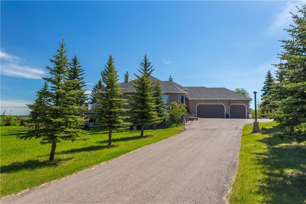 OPEN HOUSE JULY 12/2020 1-3.30PM!!!-SIMPLY....BEAUTIFUL!!!-BEAUTIFUL 5.66 ACREAGE within city limits with a stunning view of the mountains and downtown skyline. Custom built walkout bungalow with more than 3700 SQ FT of developed area.9 FT ceiling throughout the main floor with a private office, center living room with large windows and a huge deck, incredible master bedr. with a 5 pcs ensuite. Walkout fully finished basement with 3 bedr. and two full bath.Triple car heated attached garage, greenhouse,shed and almost 1500 SQ FT custom built workshop. SIMPLY...BEAUTIFUL!!!-PLEASE VIEW OUR VIRTUAL TOUR-