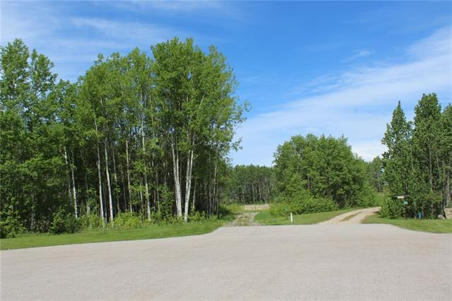 This beautiful 2 acre lot has all the features for a great life. Trees, paved roads, close to Calgary, ponds, wildlife, privacy. The water coop connection is to the lot line and is paid for. It is tucked in a cul-de-sac- off a cul-de-sac just off Woodland Road, in Beautiful Bearspaw. This property is connected to the Rocky View Water Coop.
