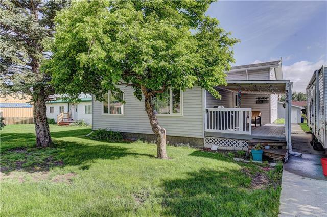 Great family home at a great price.  So much to offer here.  Over 1400 square feet of developed space.  5 bedrooms and 3 full baths.  For your comfort this home has a high efficiency furnace.  Hot water on demand, and central air conditioning.  The kitchen is nicely updated with stainless steel appliances.  Enjoy the summer evenings and mornings on your private covered veranda, or work on and store the toys in the oversized double garage.  Tons of parking.  It's all right here.