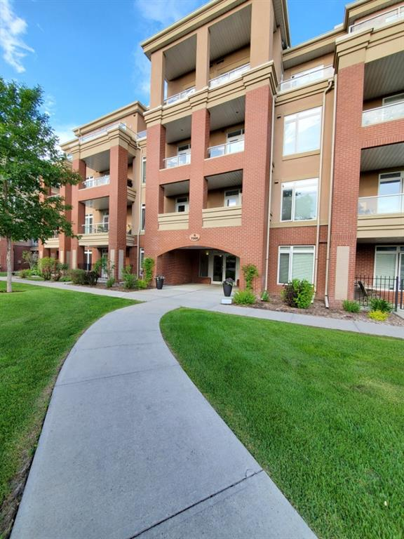 WOW!!! This beautiful, bright, main floor apartment has it's own entrance off the patio in one of Calgary's most desirable community. This unit's patio is facing a green space with beautiful mature trees. Big windows allows tons of sunlight creating a bright atmosphere. Cold days feel extra cozy with the heated floors and gas fireplace. Open kitchen concept with maple cabinets. A big, curved, and raised Breakfast bar.  The master bedroom has a built in wall unit and a very large window. The spacious en-suite has double sinks, a big soaker tub and walk in closet.  Second bedroom also has a big window and a full bath. Titled parking and storage cage are in the secure heated underground parking area w/bike room and car wash. Enjoy the well equipped gym, guest suite and party room. Very convenient location, just west of the Shaganappi Golf course, walking distance to schools, West brook mall and C train. Just minutes away from Downtown.
