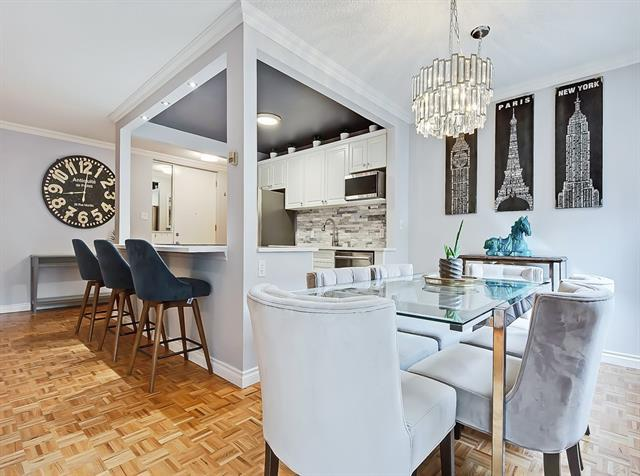 OPEN HOUSE: SUNDAY, JUNE 21, 12:00PM-2:00PM!!  ONE OF A KIND, turn-key condo in desirable UPPER MOUNT ROYAL!  Extensively UPDATED and boasting a MASSIVE, PRIVATE, SE-Facing PATIO (Over 900 SQ.FT... This is NOT common space)!!  The bright, open main living space is beautifully accented by classic parquet hardwood, with a smart layout allowing for your living room, office/flex space, dining space, and open kitchen!  The updated kitchen is a fantastic focal point in the main area, with all newer stainless steel appliances and an excellent selection of stone backsplash and modern marble-looking quartz countertops with an eating ledge!  Enjoy your spacious Master bedroom with cozy carpet flooring and a fully renovated en-suite!  The 2nd bedroom is also carpeted and the 2nd FULL BATH is also fully renovated!  COVERED, TITLED PARKING, assigned storage locker, fantastic common green space!  Well-managed building - Condo Fee recently lowered!  Book a showing today!