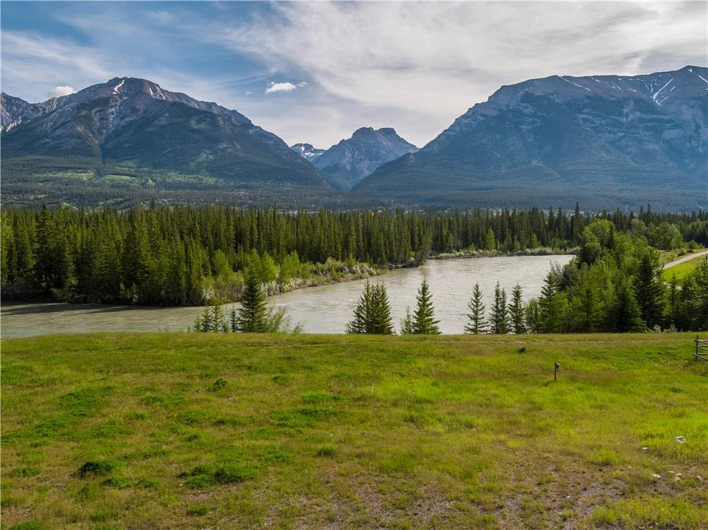 Likely the last developable lot on the Bow River in the Mountains!  Oversized 140' wide x 210 ' deep with amazing views in every direction.  Options for development include: 1.  Develop yourself 2.  Seller to can design-build on 140' lot 3. Can be subdivided into two 70' lots 4.  Seller to can design-build on two 70' lots Two single-family home designs available.  Contact Dale for more information.