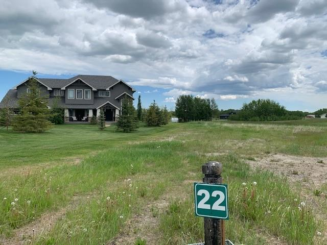 Are you ready to build your dream home? This incredible pie shaped, 2 acre lot is waiting for you! This is the last lot left in this 9 lot subdivision, minutes from all the amenities of NW Calgary.  Every lot has mountain view and all utilities brought to the property line. This is the SE corner lot, and with all other homes already built, there will be no construction noise to deal with once your dream home is built.