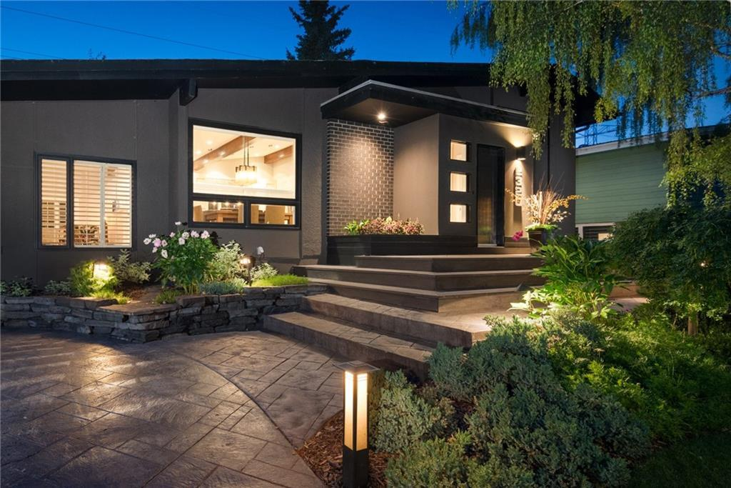 You got where you are by seizing opportunities...Here's your next big win! 74' WIDE LOT, tree-lined streets, bike paths, parks, shopping, K-Univ. schools, one of Calgary's most prestigious golf courses and only 8 MINS TO DOWNTOWN! And, the 2345 square foot home & incredible yard will perfectly fit your lifestyle. Interior & exterior spaces have been professionally designed & meticulously constructed with custom one-of-a-kind finishes to provide the ultimate in form & multi-function. The entire upper floor is your Master Suite with closet millwork unlike anything you've seen, and an Ensuite that's as much a piece of art as a private retreat. The Main floor is equally perfect for entertaining or a quiet night at home. The 3rd level has 2 more Bedrooms and a beautiful Full Bath, and the 4th level is the perfect Media Rm. With 3 sitting areas nestled into the private yard, the outside becomes a true extension of the home, and the heated Man-Cave will become the hub of any party. You deserve to live this well!