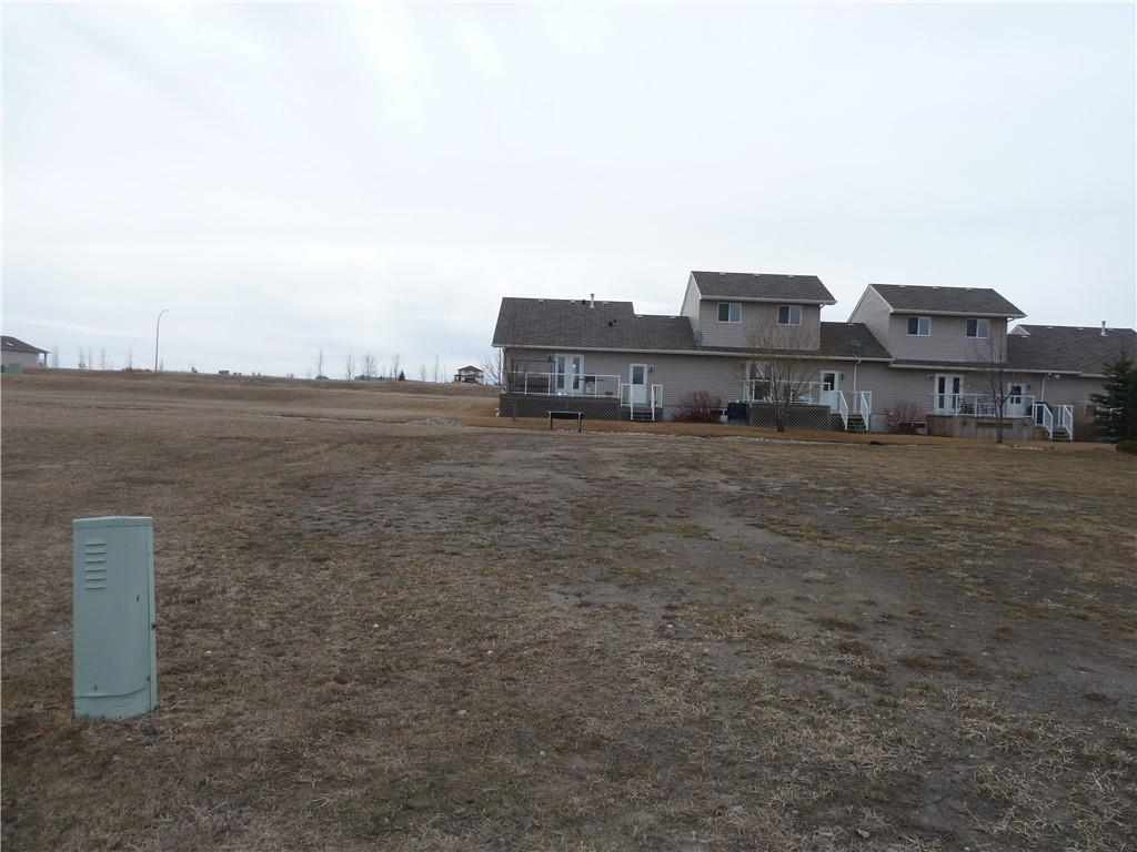 Looking for a life style change with no more snow removal or yard work? This serviced lot in a well run adult living community ( 50+) is perfect for you to build you dream retirement home. Lot located within walking distance to an 18 hole golf course in Vulcan and Vulcan has all the services and amenities a person needs. No commitment to build and only pay partial condo fee for vacant lot. Buy the lot now and you will have lots of time to plan. Call for more details.