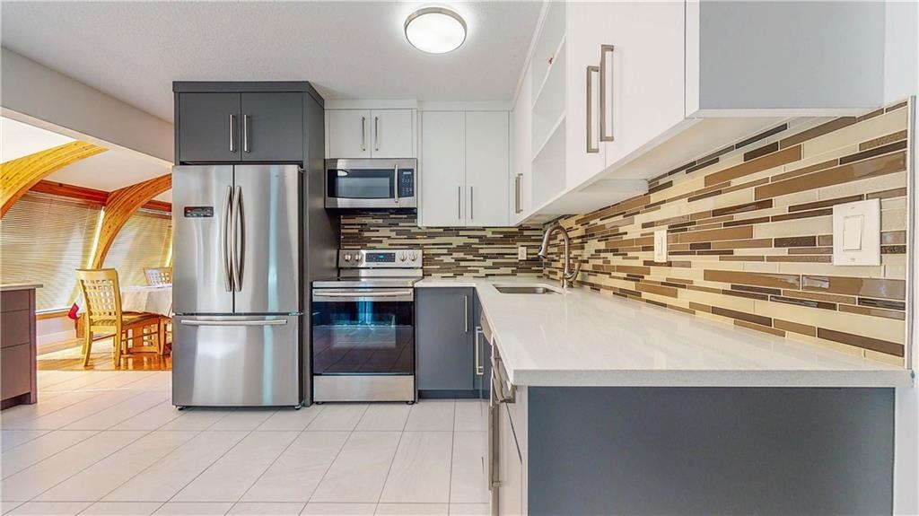 Welcome home ! Why build new if you can have fully renovated home on 80x110 LOT in desirable community of Cedarbrae!! Backyard is a private OASIS with a 0.17 ACRE CORNER lot, double parking pad that can be used for RV plus a 21x24 ft double attached garage!It has over 2400 sqft of developed living space!You are greeted with a large living room,hardwood flooring,formal dining room,incredible solarium with beautiful windows off the kitchen.Upstairs,a large master bedroom with 3 piece ensuite,2 additional bedrooms plus a 4 piece bath. The main floor has your 4th bedroom or den, large family room laundry room and 1/2 bath. NO CARPET throughout the house! Developed basement has large above ground windows and a wet bar,newer roof and furnace. This mature corner lot has a tiered deck, bright and sunny WEST facing yard,loads of mature trees and privacy hedge in the front yard, Walking distance to both public & separate elementary schools and junior high.Walking distance to path to fish creek and south Glenmore.